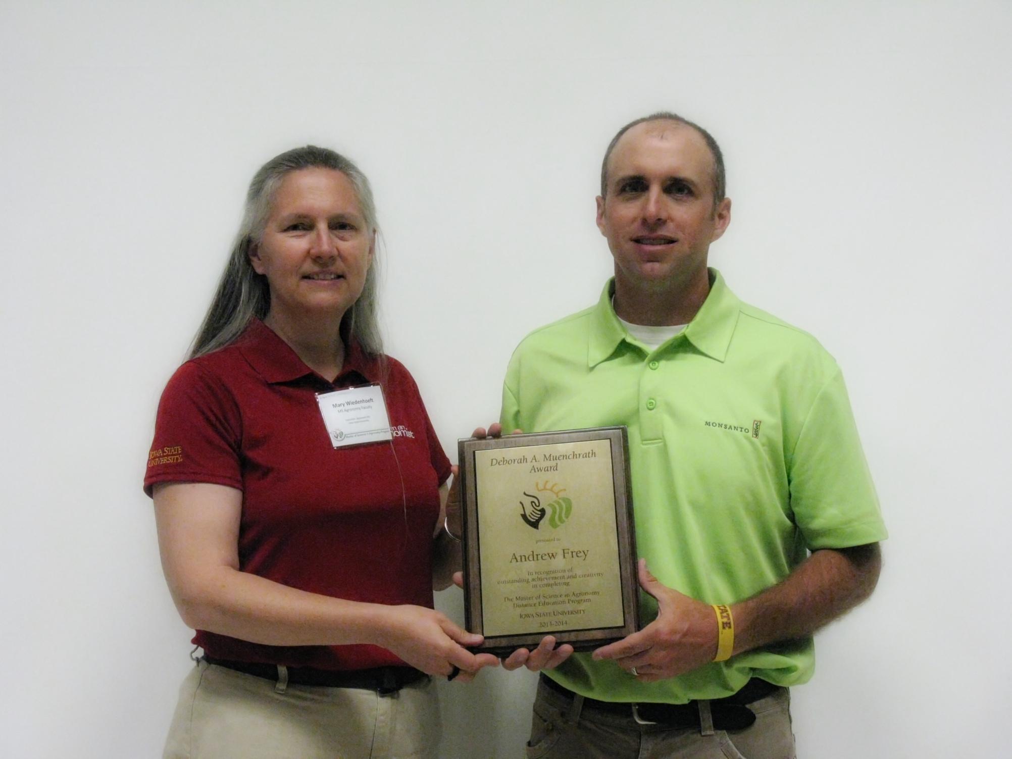 Frey receiving Muenchrath award