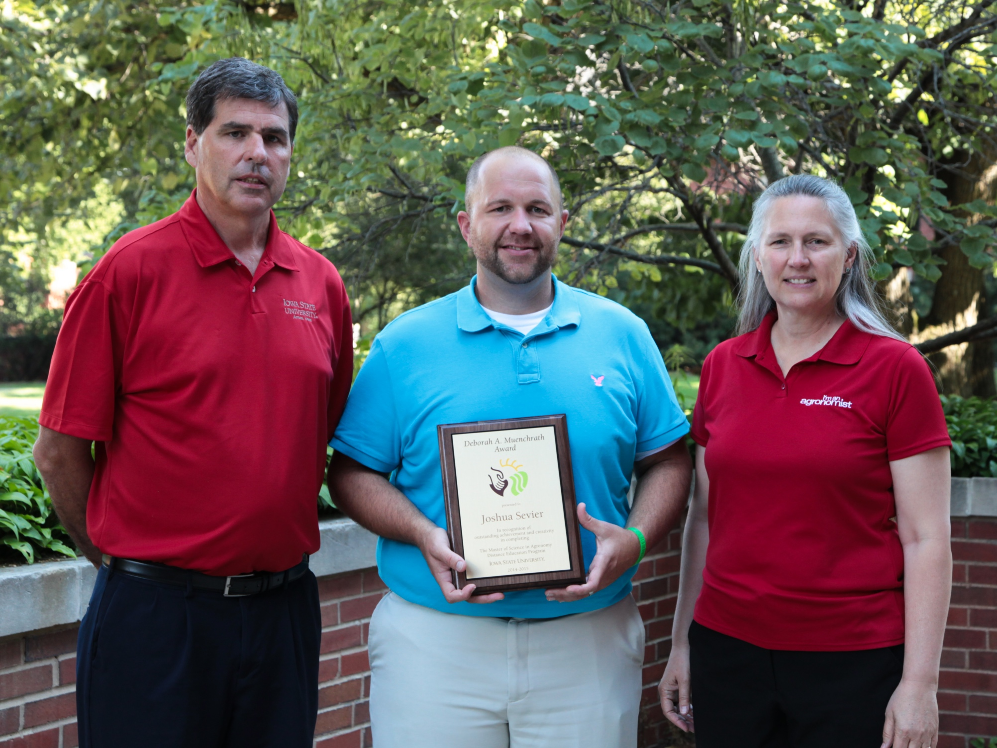 Sevier receiving Muenchrath award