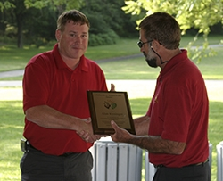 Keninger receiving award